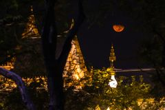 The Royal funeral pyre for King Bhumibol Adulyadej. The moon rise above the Royal funeral pyre for King Bhumibol Adulyadej at midnight in Bangkok, Thailand Stock Image