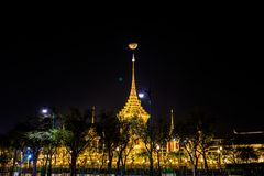The Royal funeral pyre for King Bhumibol Adulyadej. The moon rise above the Royal funeral pyre for King Bhumibol Adulyadej at midnight in Bangkok, Thailand Stock Photo