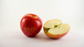 Royal gala apple. Whole ripe red gala apple and fresh half Royalty Free Stock Photography