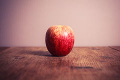 Royal gala apple on wooden table Stock Images