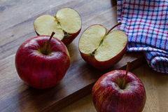 Royal Gala apples and cloth on wooden background with copyspace Stock Photography