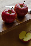 Royal Gala apples and knife on wooden background with copyspace Royalty Free Stock Photos