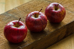 Royal Gala apples on rough rustic wooden background with copy-space Stock Photography