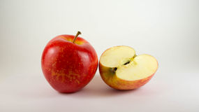 Royal gala apples. Whole ripe red gala apple and fresh half Royalty Free Stock Photography