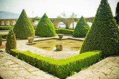 Royal garden. Perfectly shaped bushes and small pond in a garden Stock Photo