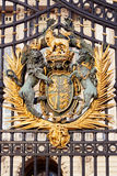 Royal golden coat of arms at the main Buckingham Palace gate royalty free stock photography