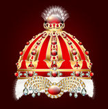 Royal golden crown with an ornament and precious stones Royalty Free Stock Image