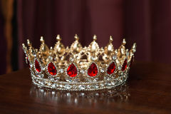 Royal golden crown with red stones. Garnet, ruby Royalty Free Stock Photos
