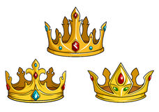 Royal golden crowns with jewelry Stock Photos