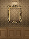 Royal golden frame on the wall in interior. royalty free illustration