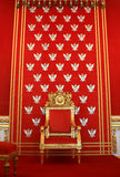 Royal golden throne. On the red orginal background with eagles Royalty Free Stock Photos