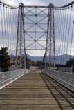 Royal Gorge Bridge. The Royal Gorge Bridge in Colorado soars majestically before a mountain backdrop Royalty Free Stock Photography