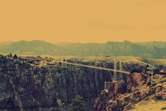 Royal Gorge Bridge and Park - Suspension bridge over the narrow Canyon of the Arkansas River in Colorado with mountains in backgro. The Royal Gorge Bridge and stock image