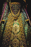 Royal gown. A view of an exquisite, highly decorated and embroidered formal dress usually associated with traditional royalty Stock Photography