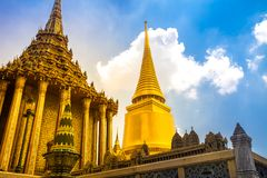 Royal Grand King Palace in Bangkok, Thailand. Beautiful Landmark of Asia, architecture, golden decoration against blue sky. Landscape of the capital city royalty free stock photo