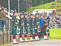 Royal Guard at Braemar. Soldiers of the Black Watch from Fort George acting as the Queen's bodyguards at Braemar Royal Gathering with the Officer in charge Royalty Free Stock Image