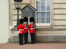 Royal guard at Buckingham Palace. When the Queen is in residence, the Queen's Guard has four sentries each posted at Buckingham Palace, on the forecourt and St Stock Photography