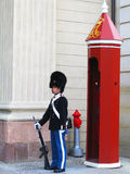 Royal Guard guarding Amalienborg Castle in Copenhagen, Denmark Stock Photo