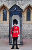 Royal guard at windsor castle. A royal guard on duty at Windsor Castle, England, UK Royalty Free Stock Images