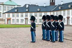 Royal guards in the Fredensborg palace in nasty weather Royalty Free Stock Images
