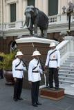 Royal Guards  at Grand Palace. Bangkok, Thailand - Feb 20, 2006: Royal Guards of Thai King changing over in front of the Grand Palace Royalty Free Stock Image