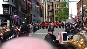 Royal Guards march parade after Royal Wedding - perspective front view. Windsor, United Kingdom - May 19, 2018: Front view of The Royal Guards march around stock video