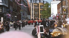 Royal Guards march parade after Royal Wedding - perspective front view. Windsor, United Kingdom - May 19, 2018: Front view of The Royal Guards march around stock video footage
