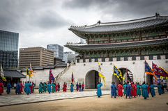 Royal guards near the gate of Seoul Palace. Royal guards in red and blue uniforms marching in front of the Main gate of Gyeongbokgung Palace, Seoul, South Korea Stock Images