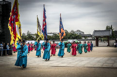 Royal guards near the gate of Seoul Palace. Royal guards in red and blue uniforms marching in front of the Main gate of Gyeongbokgung Palace, Seoul, South Korea Stock Photo