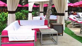 Royal Hawaiian Hotel, Honolulu, Hawaii -4/27/2018 - Lounge chairs and umbrellas by the pool at the Royal Hawaiian Hotel in Hawaii. Poolside area at the Royal stock photos