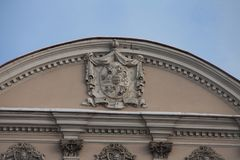 Royal heraldic coat of arms. On the pediment of the palace Royalty Free Stock Image