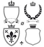 Royal Heraldic Crests or Emblems. Set of crests with royal crowns, wreaths and banners with blank space Stock Images