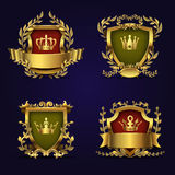 Royal heraldic vector emblems in victorian style with golden crown, shield and laurel wreath. Royal golden award crown with shield illustration Royalty Free Stock Images