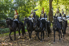 Royal Horseguards in Hyde Park. LONDON, UK - OCTOBER 1ST 2015: Royal Horseguards travelling through Hyde Park in London, on 1st October 2015 Royalty Free Stock Photo