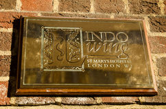 Royal Hospital sign, Paddington. LONDON, ENGLAND - JULY 19: Brass plaque on the private Lindo Wing of St Mary's Hospital, Paddington on July 19 2013.  The Royalty Free Stock Photos