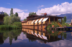 Royal Houseboat in Kashmir. A beautiful and rich royal houseboat standing in lake in Kashmir Royalty Free Stock Photo