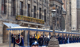 Royal inauguration in the Netherlands. King Willem-Alexander of the Netherlands leaves with his wife Queen Maxima the royal palace on the Dam square in Amsterdam Royalty Free Stock Image