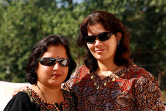 Royal Indian women. Two modern Indian glamorous women from a rich and royal family stock image