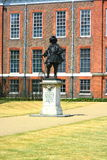 Royal Kensington Palace, London. Kensington Palace with a statue of of William 3rd in front of the austere brickwork that identifies the Palace, once home to Stock Image