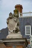 Royal lion statue guards at the gate of the governors mansion Royalty Free Stock Photography