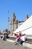 The Royal Liver Building and tourists. Royalty Free Stock Image
