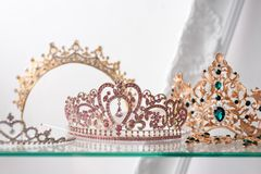 Royal luxury gold and silver crowns decorated with precious stones. Diamond tiaras with gemstones for prom and wedding Royalty Free Stock Photo