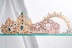 Royal luxury gold and silver crowns decorated with precious stones. Diamond tiaras with gemstones for prom and wedding Stock Photo