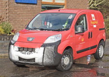 Royal Mail Delivery van. An image of a Royal Mail postal delivery van which has been through a shower of snow Stock Photography