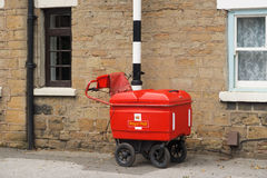 Royal Mail high capacity trolley chained to a post Royalty Free Stock Image