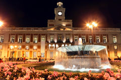Royal Mail House at night and beautiful fountain. With flowers in Madrid, Spain Stock Photography