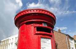 Royal Mail Pillar Box. LONDON, UK - MAY 24, 2014:  A bright red pillar box on a street corner, part of the Royal Mail infrastructure that operates across the UK Stock Photos