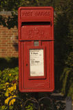Royal mail post box. The end of the royal mail looms ! post office closures in villages. mail services reduced and may go altogether. image of an old bright red stock photo