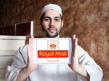 Royal mail postal shipping company logo. Logo of royal mail postal shipping company on samsung tablet holded by arab muslim man Stock Photos