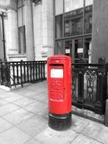 Royal mail. Red post box on a street Royalty Free Stock Photos